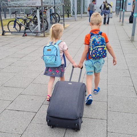 Children pulling a suitcase