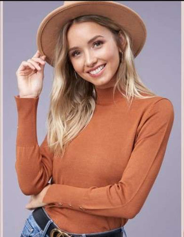woman in brown blouse and hat