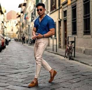 Male Model in Blue Dress Shirt and Cream Slim Fit Pants with Brown Shoes