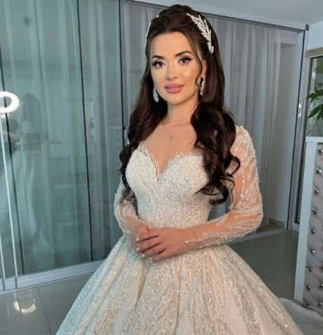 Bridal dress model with long hair and necklace earrings and bracelet