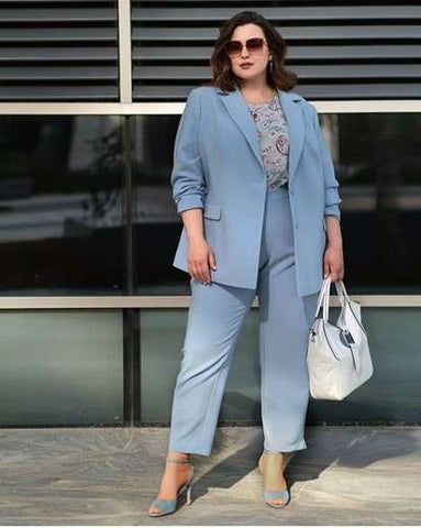 Plus size model in sky blue business suit with blazer and pants