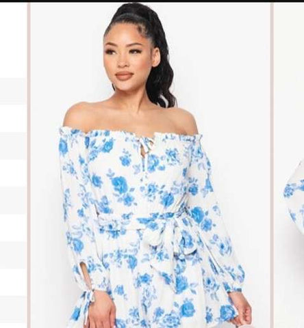 Woman in off shoulder white and blue floral dress