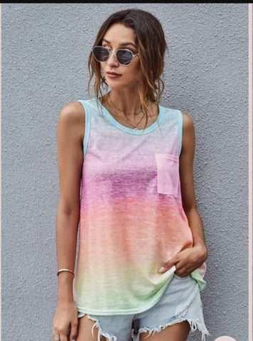 Woman in tank top dress multicolor and denim shorts