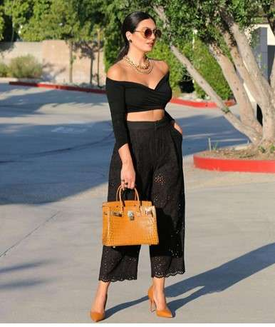 woman in black 2 piece pant and off shoulder top