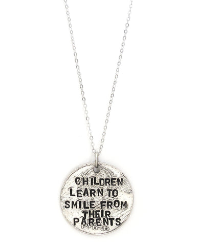 'Children Learn To Smile From Their Parents' Silver Necklace