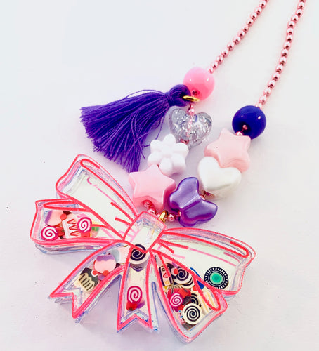 pink bow shaker necklace