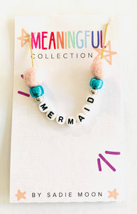 meaningful pom pom mermaid necklace