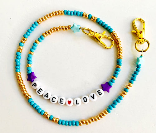 turquoise and gold with the words peace and love