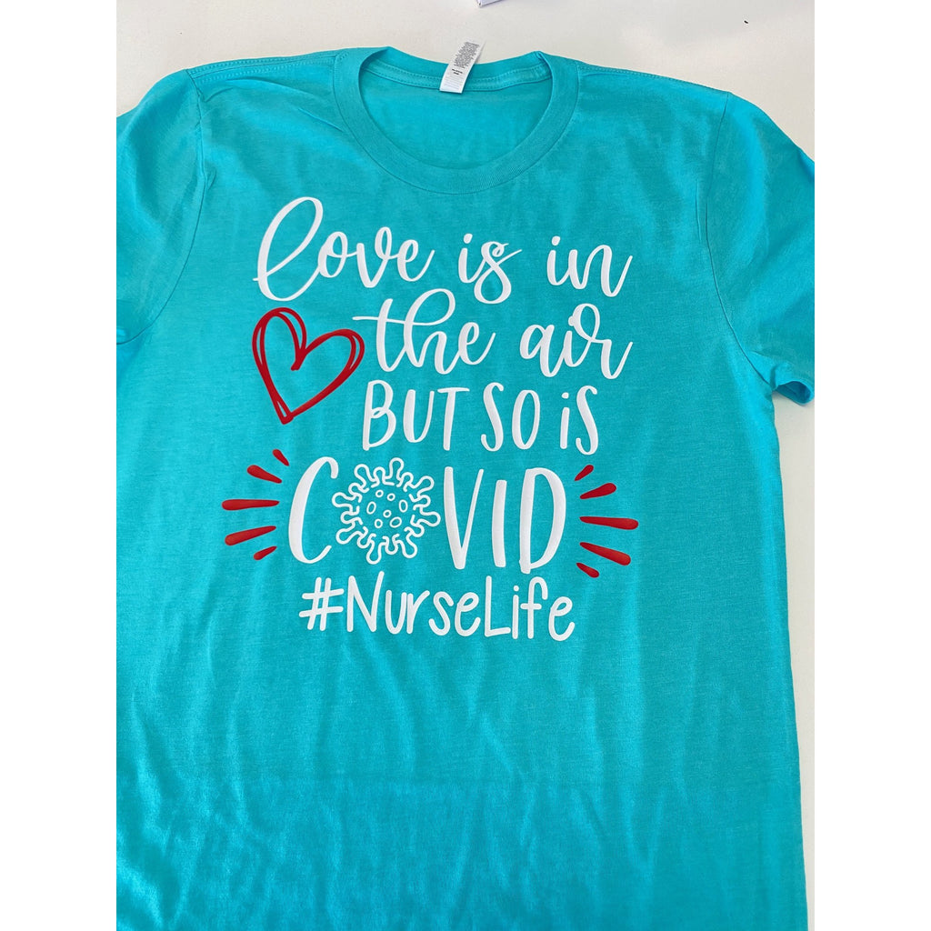 love is in the air but so is covid teal shirt with white and red text