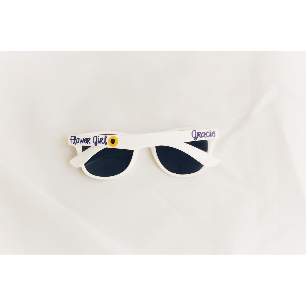 White youth sunglasses with flower girl text on the arms