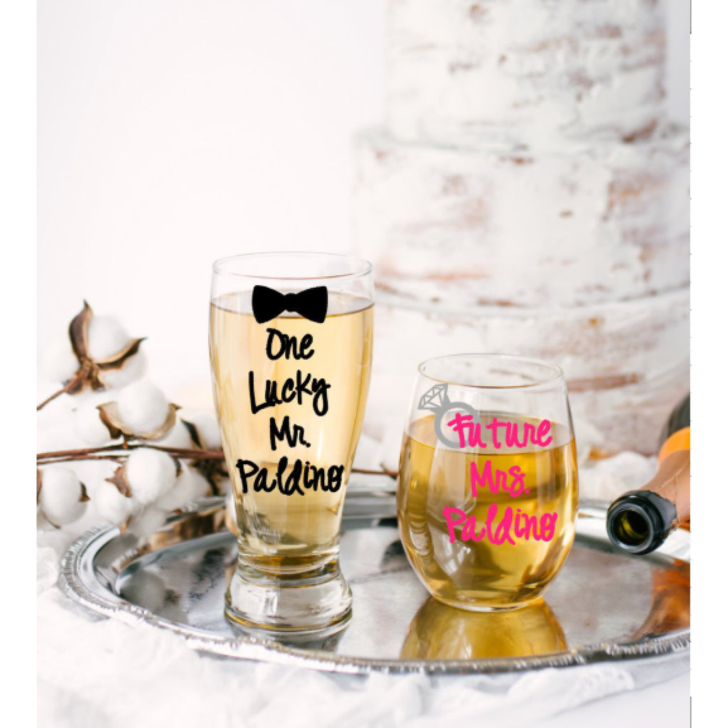 one lucky mr and bow tie with black text and future mrs stemless wine glass