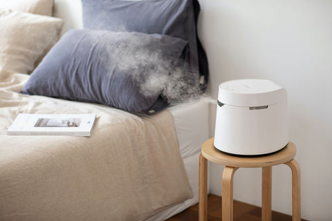 Carepod humidifier blowing steam in a bedroom