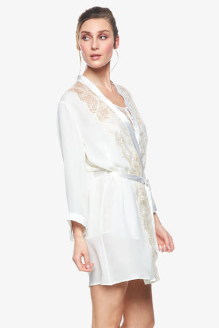 Model wearing a closed Cordelia silk bridal robe in pearl-white