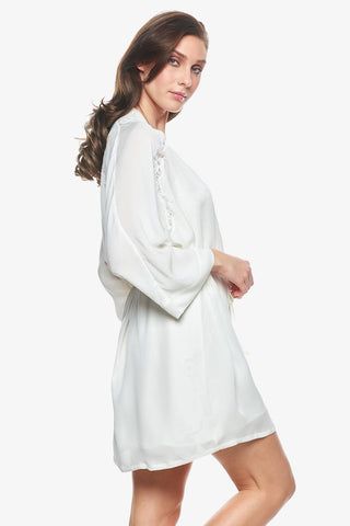 Model showcasing Sigrid short bridal robes in pearl-white