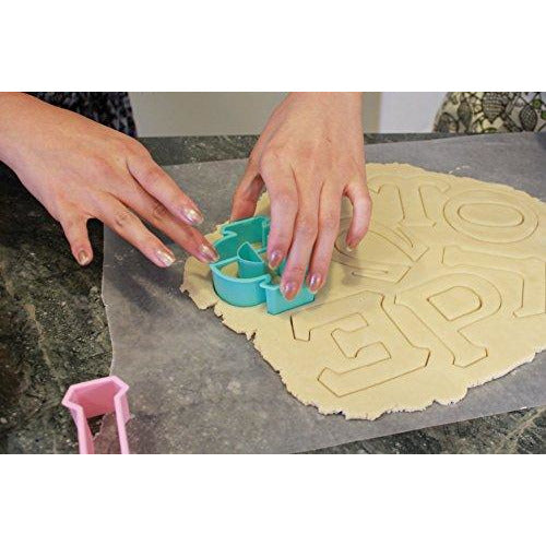 LiveGreek® Greek Alphabet Cookie Cutters - cutting cookie dough #LiveGreek #ScottKaminski #MiaKaminski #Panhellenic #sororitysupplies #bigsislilsis #students #college #rush #graduationgifts #sororityhouse #fraternal #fraternity #cookiecutters #artstencil #GreekAlphabet
