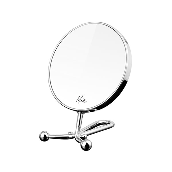 Mia® 10x/1x Folding Mirror - Handheld + Table + Wall - Polished Chrome - shown folded and unfolded with lady looking into mirror - #MiaKaminski #Mia #beauty #mirrors #lovethis #life #woman #vanitymirror