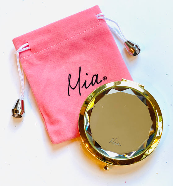 Mia Beauty Jeweled Compact mirror with gold metal and clear glass rhinestone and pink drawstring pouch