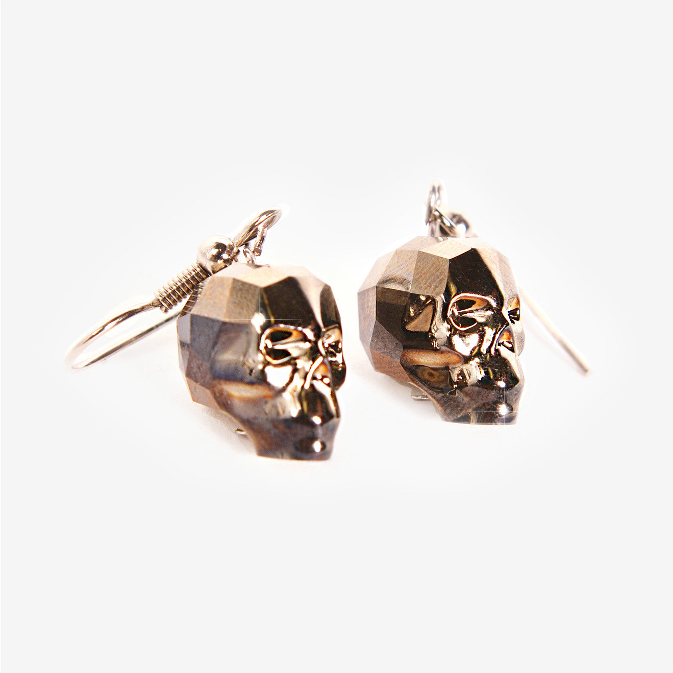 CRYSTAL SKULL EARRINGS | Gold Shadow Chromium Mila Fargo T shirt