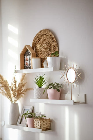 artificial potted plants on a shelf