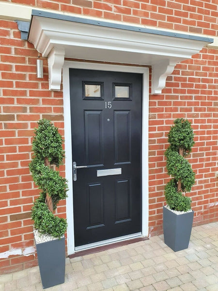 artificial topiary outside front door