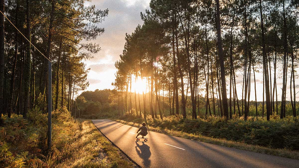 yow surfskate on open road with sunlight shining