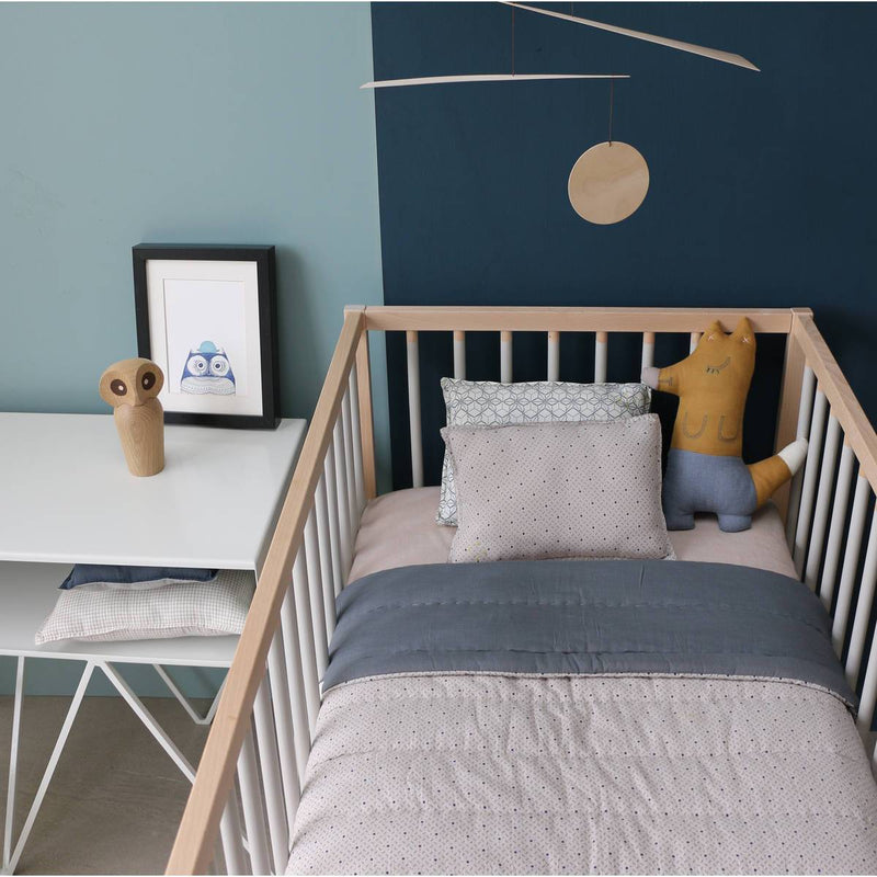 Camomile London | foxy kids cushion | ochre and blue - in cot