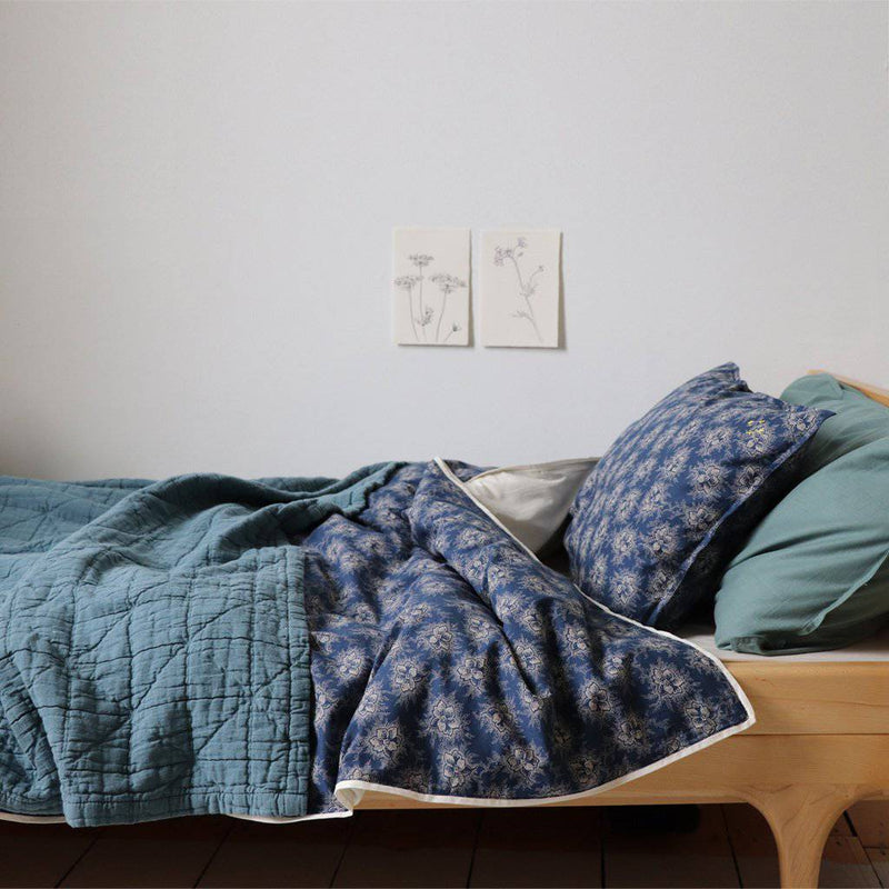 Camomile London | diamond single cotton blanket | airforce blue - bed