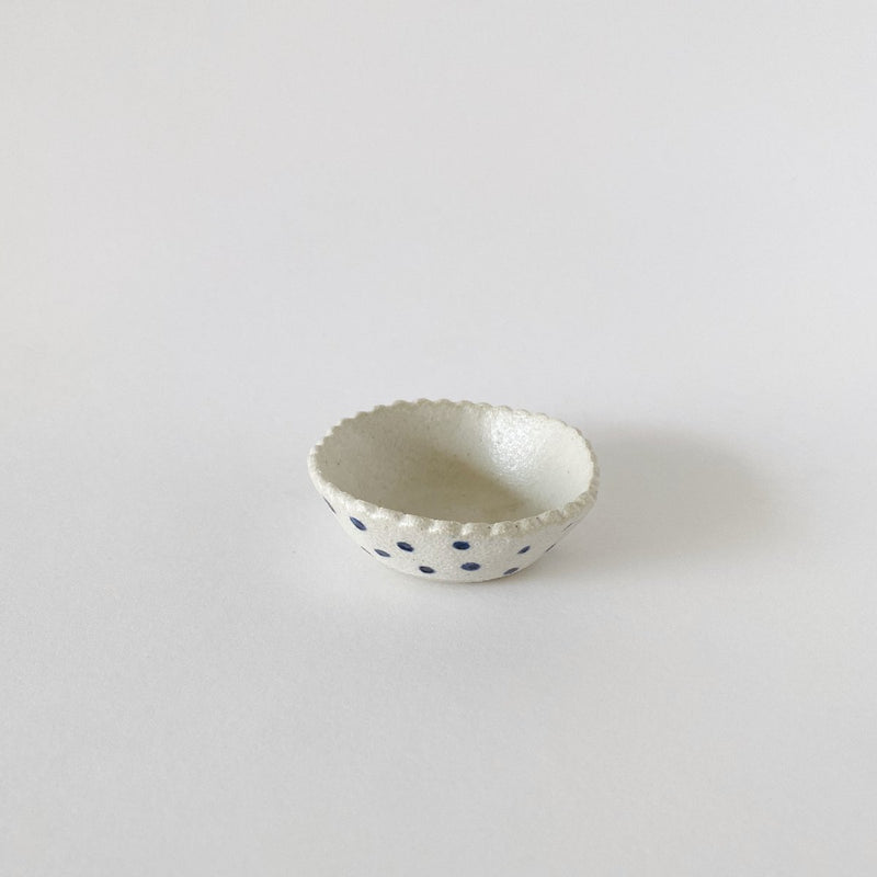 Clay Beehive | scalloped ceramic bowl | spots outside