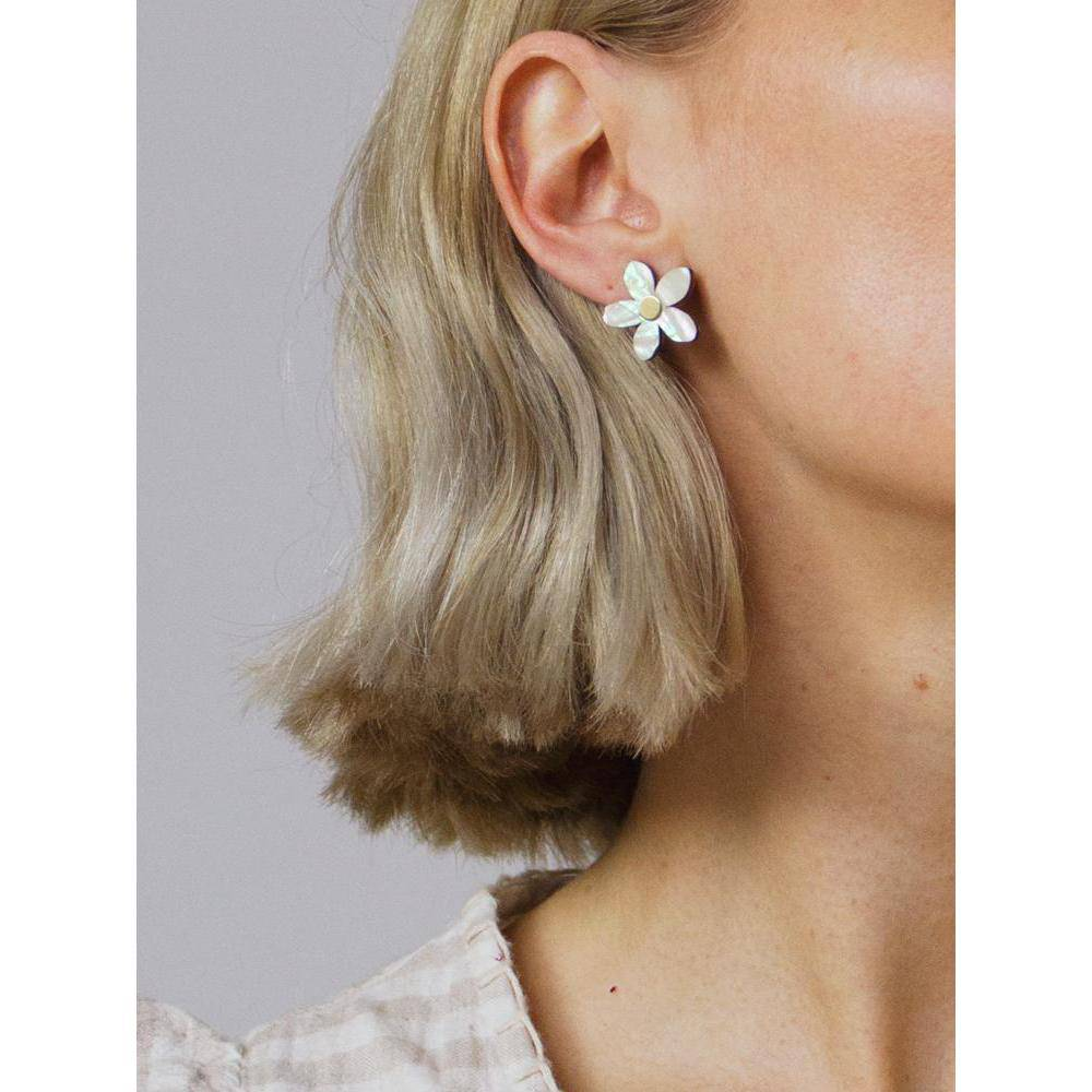 Wolf and Moon | mini orange blossom stud earrings | mother of pearl - wearing