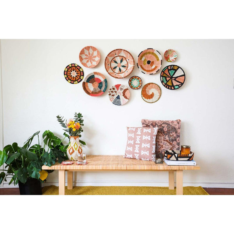 african woven bowl collection on wall