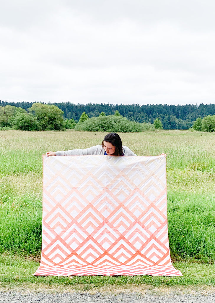 Cabin Peaks in Living Coral Ombre Quilt