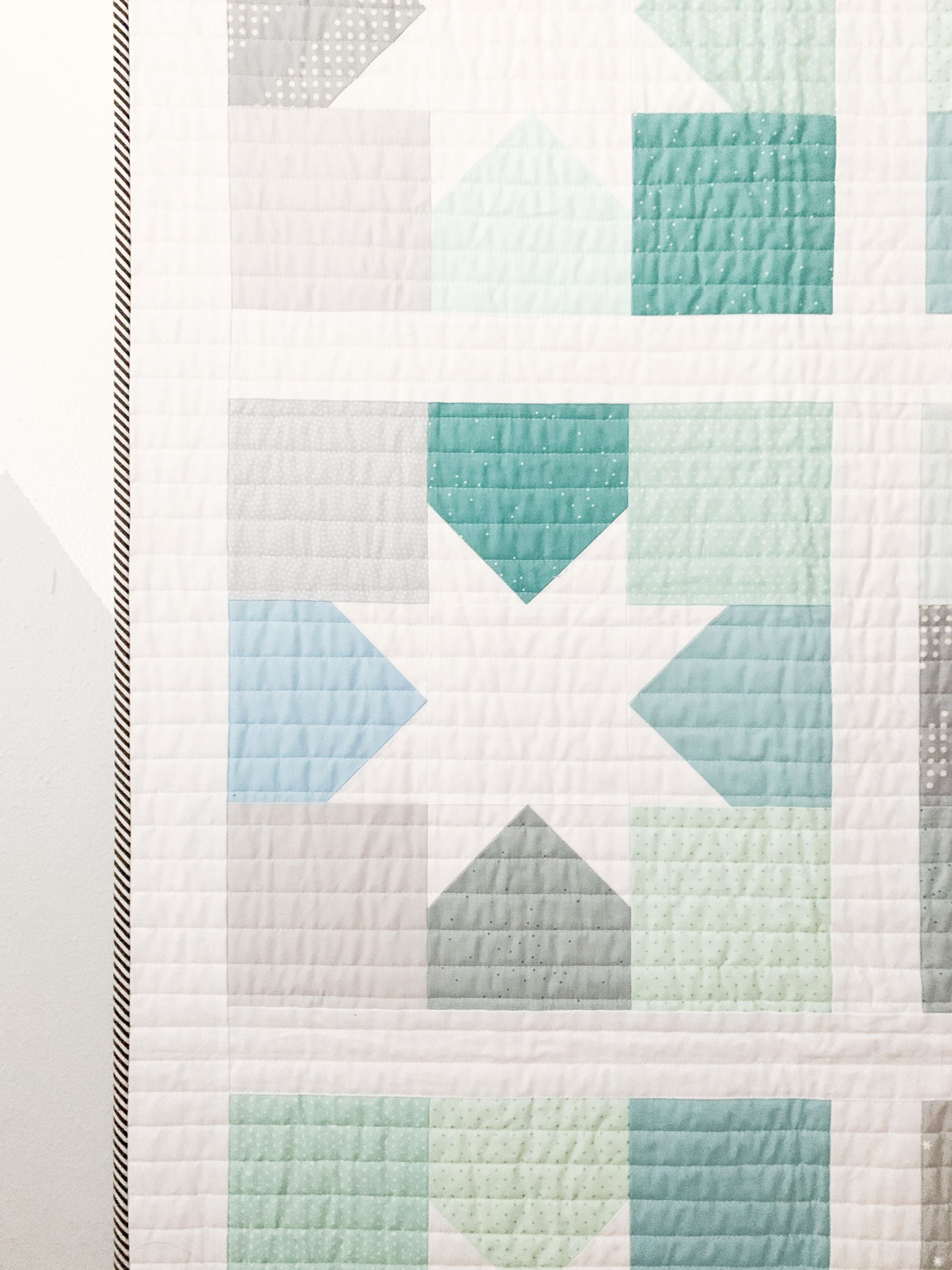 Quilting and binding detail on a baby boy quilting
