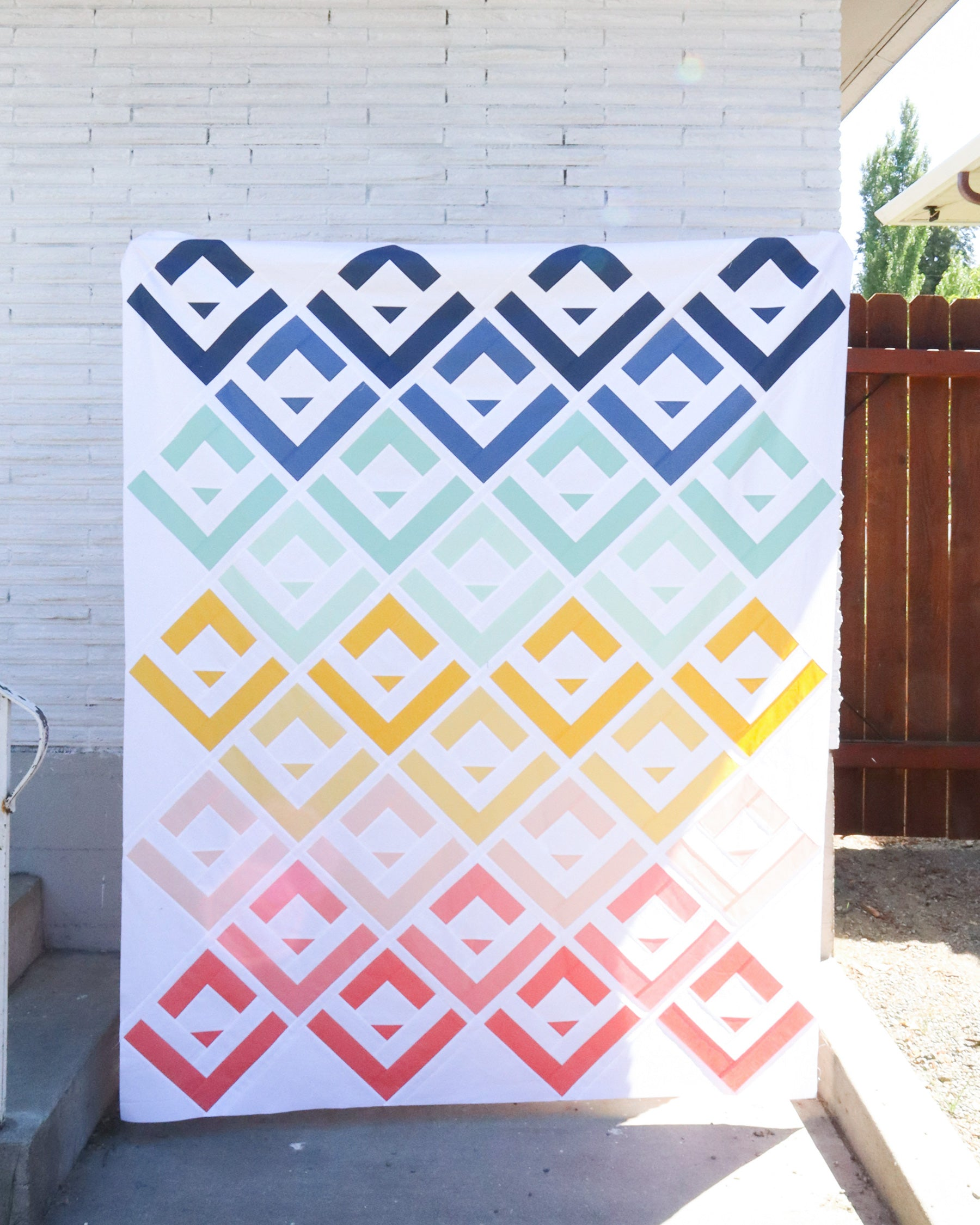 Cabin Valley quilt top - a modern log cabin quilt pattern by Cotton and Joy