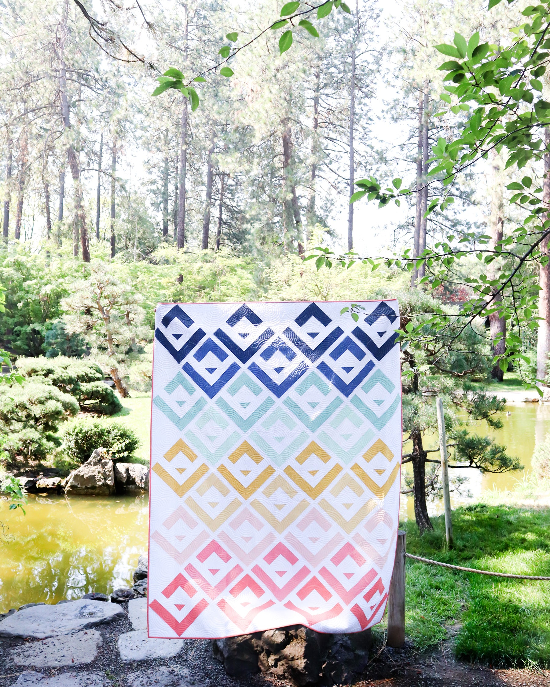 Cabin Valley Quilt - a beginner friendly, modern log cabin quilt by Cotton and Joy