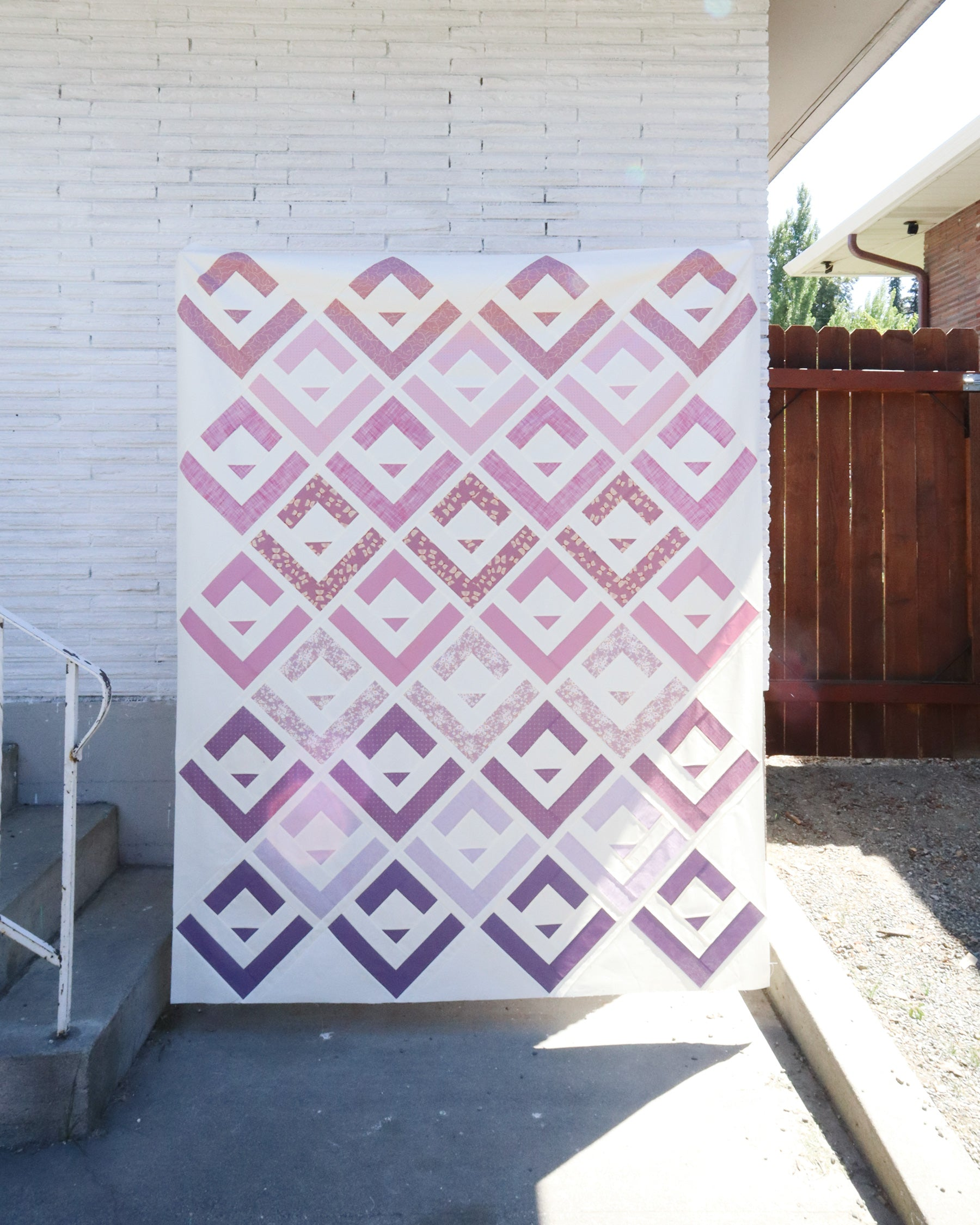 Purple Cabin Valley quilt by Cotton and Joy - a modern take on the classic log cabin quilt