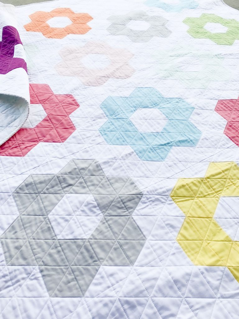 Quilting details on Hexie Blooms quilt, done with a walking foot