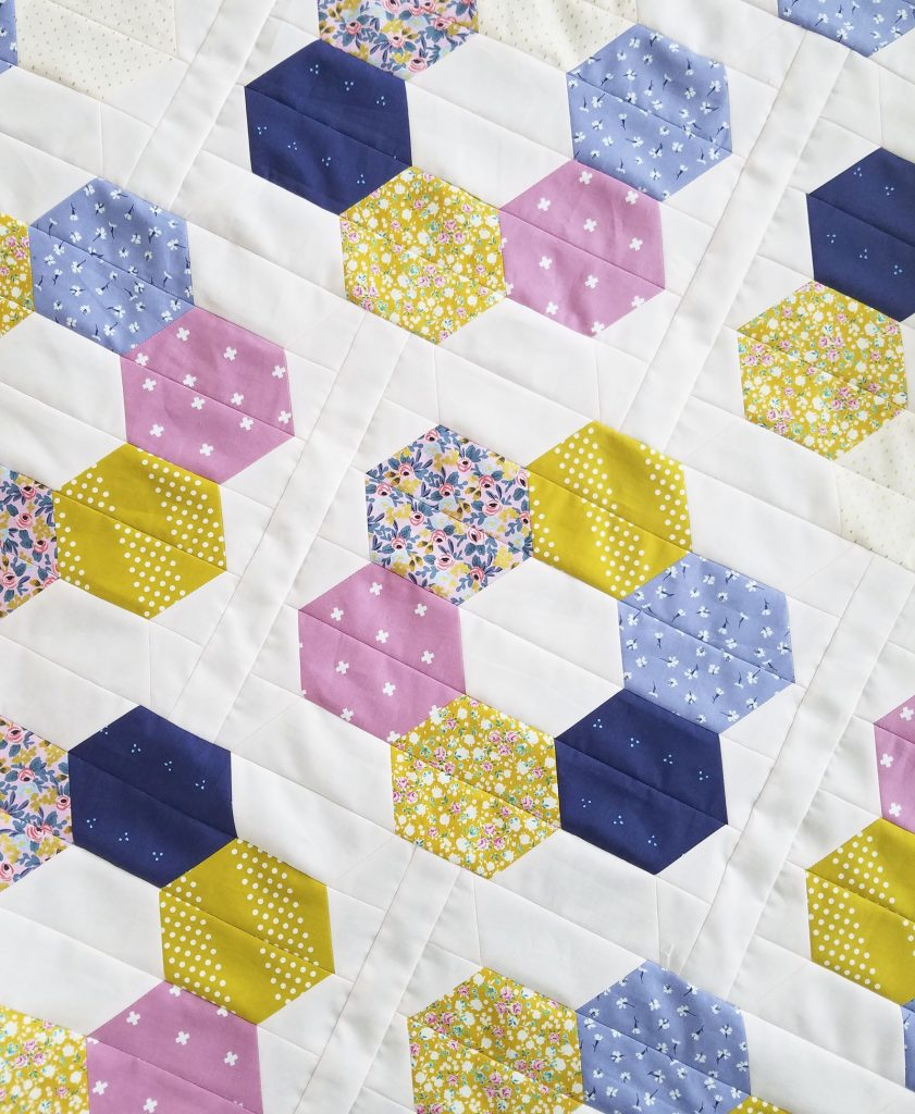 Scrappy Hexie Blooms Quilt using jelly rolls