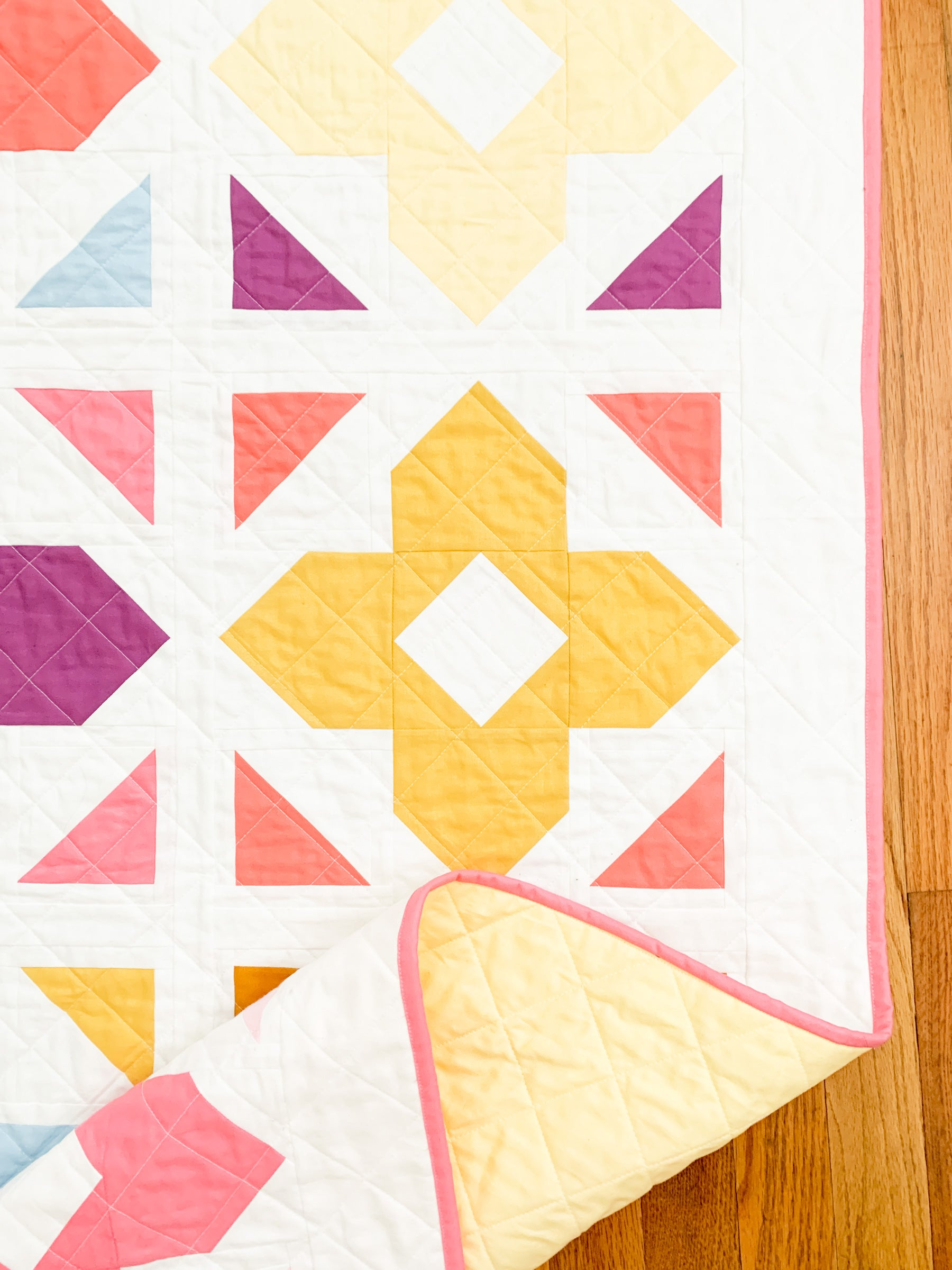 Luminaries quilt pattern by Cotton and Joy is a fun and modern, FQ friendly quilt pattern.