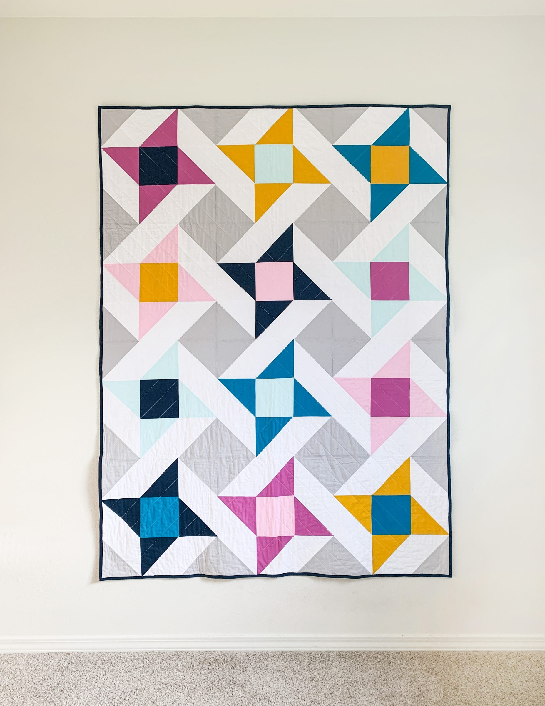 Spring quilt - stars quilt. Mighty Stars is a modern take on the Friendship Star block.
