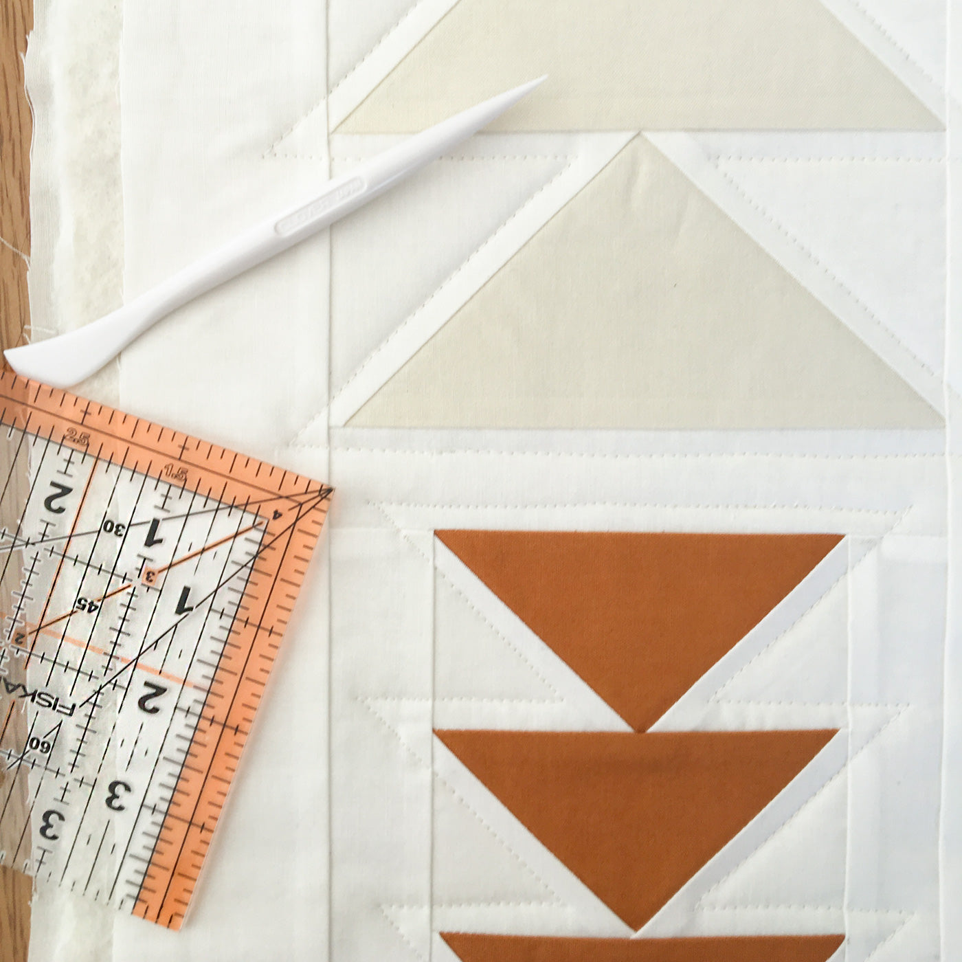 Using the hera marker by clover and ruler to mark quilting lines for straight line quilting