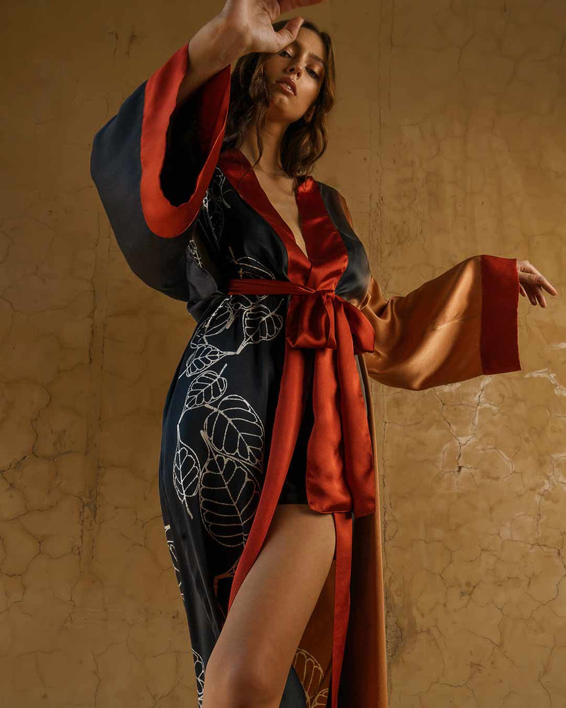 Quarzia signature kimono delivers comfort, style, elegance and the sensuality of the pure, hand decorated, satin silk.