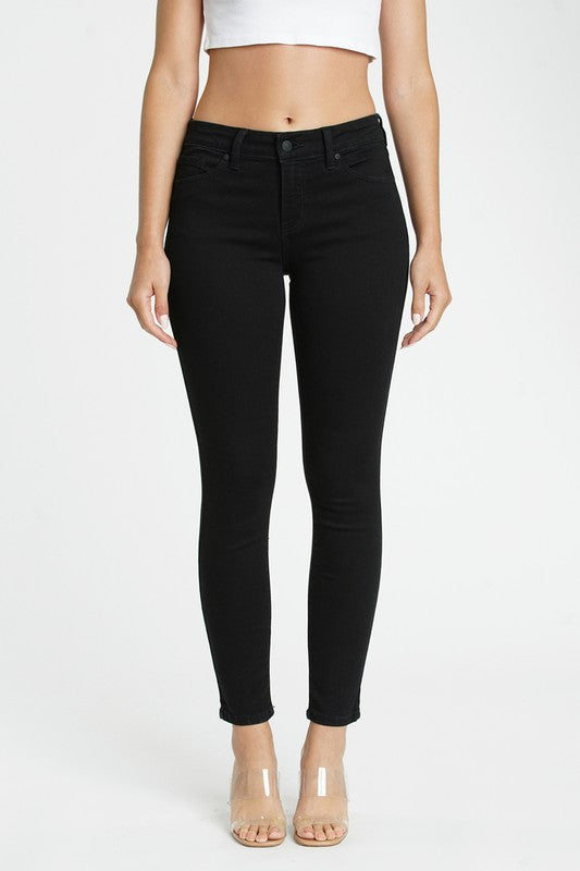 Black mid rise skinny ankle jeans