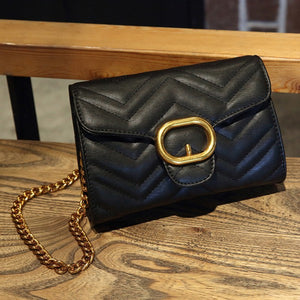 Black pattern embossed shoulder bag