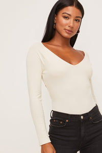 Cream LS bodysuit with back cutout