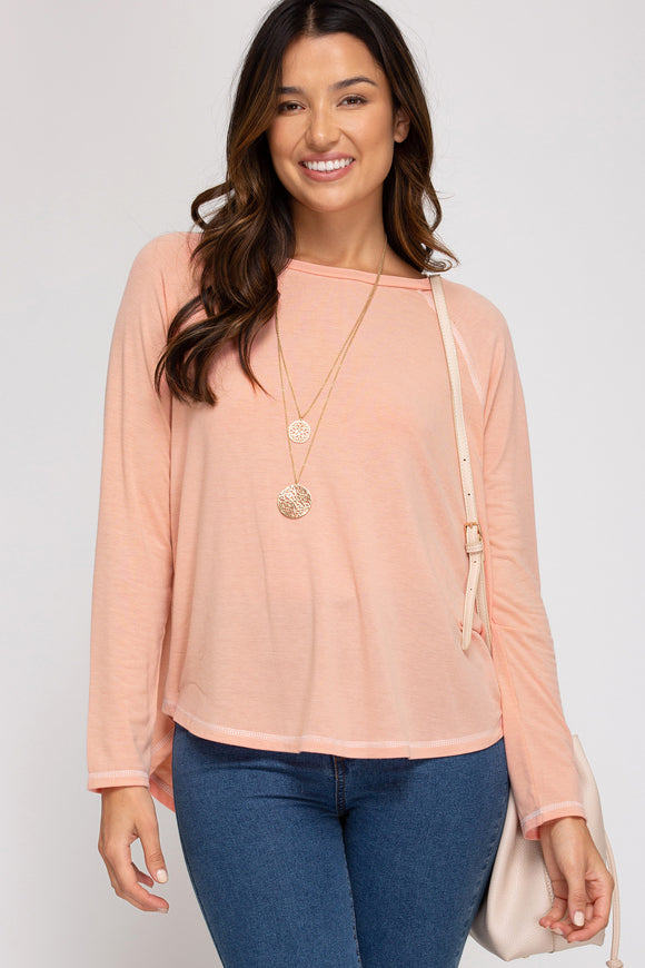 Reverse stitch long sleeve top