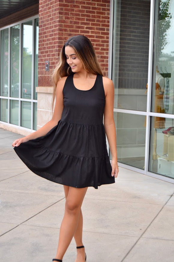 Black sleeveless tie back dress