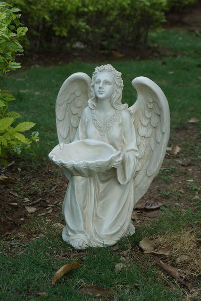 Angel Kneeling and holding Shell - Ivory