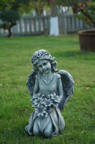 Angel Kneeling Holding Flowers