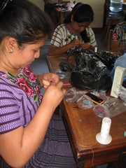 Guatemalan women doing bead work