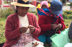 Peruvian women hand knitting alpaca easter bunny ornament